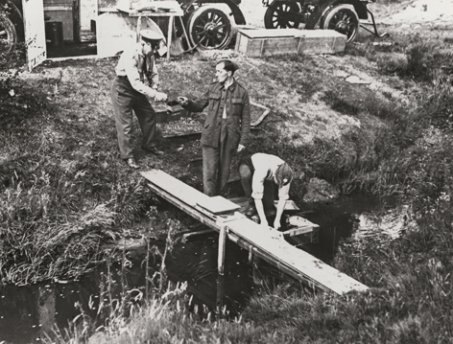 WW1 Washing glass plate negs in the river
