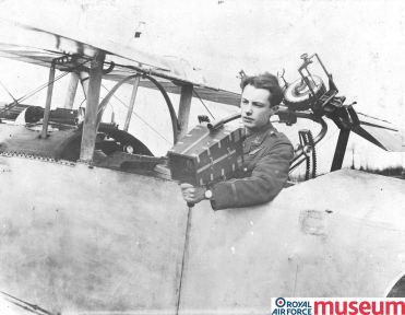 In this photograph, Lt S.C. Thynne RFC demonstrates the use of a hand-held camera for photographic reconnaissance in the back seat of a Nieuport aircraft. Lieutenant-Colonel J.T.C. Moore-Brabazon designed the first effective aerial camera in 1915.