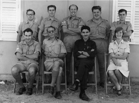 Akrotiri Ground Section 1964L-R Cpl Jim Fripp (surname), Sgt John Hollinshead, a Jordanian secondee, Sue Blennerhasset. Back row Ted Smith, Des McCoy, Cpl Pete Lowrie, Dusty Miller and a young-looking Mik Speake.