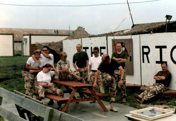 RIC Incurlik, Turkey featuring... Photogs: Sgt Gary Garbett Cpl Dave Smith ( now Abel) SAC Jamie Beck (having head rubbed by Dave Abel). Dave Able's future wife SAC Sarah Jones (now Abel) sitting on bench in front